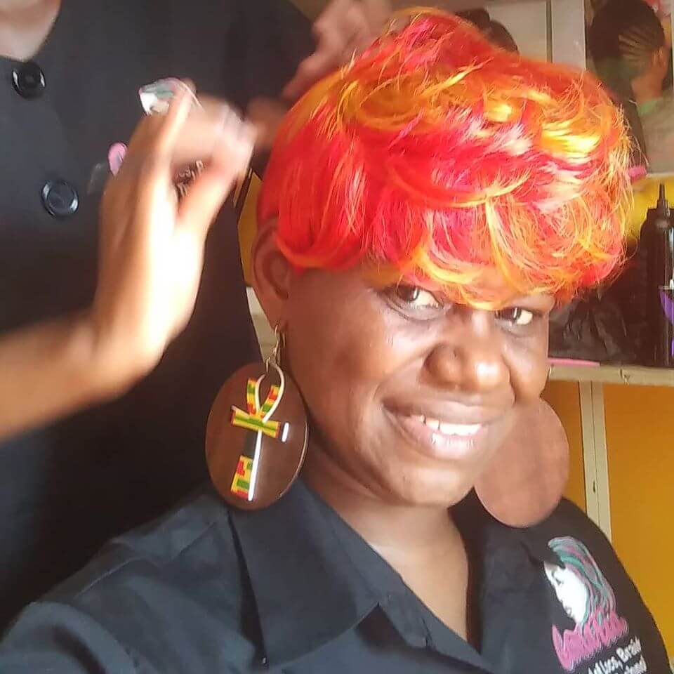 Camaria Beauty School. Student testing a hairstyle.